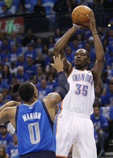 Oklahoma City Thunder forward Kevin Durant (35) shoots over Dallas Mavericks forward Shawn Marion (0) in the first quarter of Game 1 in a first-round NBA basketball playoff series in Oklahoma City, Saturday, April 28, 2012. (AP Photo/Sue Ogrocki)