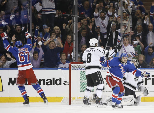 New York Rangers right wing Mats Zuccarello (36), at right, and left wing Benoit Pouliot (67) react after Pouliot scored a goal against the Los Angeles Kings in the first period during Game 4 of the NHL hockey Stanley Cup Final, Wednesday, June 11, 2014, in New York. (AP Photo/Kathy Willens)