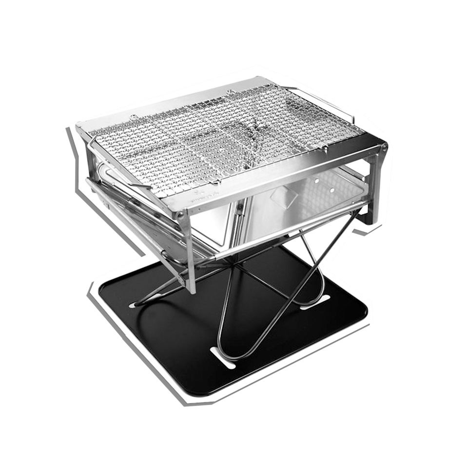 """The most perfect grill for either your backyard or the backcountry. Its sleek design packs flat for easy transportation, which will be a great addition on any camping trip your dad embarks on. $320, REI. <a href=""""https://www.rei.com/product/114852/snow-peak-takibi-fire-grill"""" rel=""""nofollow noopener"""" target=""""_blank"""" data-ylk=""""slk:Get it now!"""" class=""""link rapid-noclick-resp"""">Get it now!</a>"""