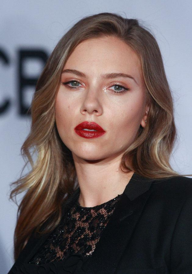 Scarlett Johansson walked the Tony Awards red carpet with dark red lips and a glossy eye make-up look. [Rex]