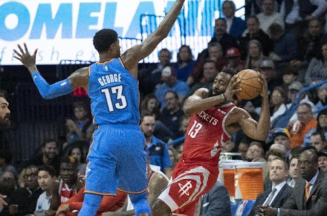 Houston Rockets star James Harden tries to shoot around Oklahoma City's Paul George in the Thunder's 98-80 NBA victory on Thursday (AFP Photo/J Pat Carter)