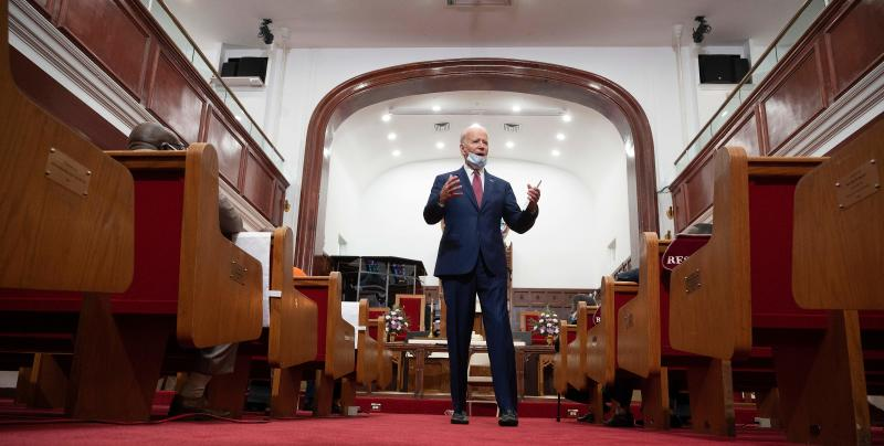 """Former vice president and Democratic presidential candidate Joe Biden meets with clergy members and community activists during a visit to Bethel AME Church in Wilmington, Delaware on June 1, 2020. - Democratic presidential candidate Joe Biden visited the scene of an anti-racism protest in the state of Delaware on May 31, 2020, saying that the United States was """"in pain"""". """"We are a nation in pain right now, but we must not allow this pain to destroy us,"""" Biden wrote in Twitter, posting a picture of him speaking with a black family at the cordoned-off site where a protesters had gathered on Saturday night. (Photo by JIM WATSON / AFP) (Photo by JIM WATSON/AFP via Getty Images)"""