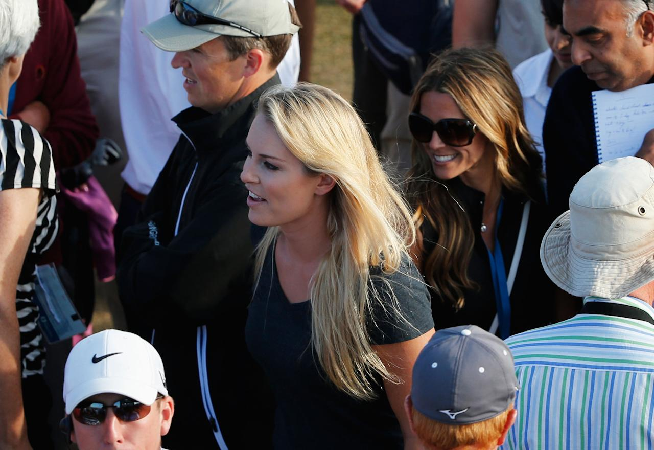 GULLANE, SCOTLAND - JULY 20: Skier Lindsey Vonn walks around the 18th green as Tiger Woods of the United States plays during the third round of the 142nd Open Championship at Muirfield on July 20, 2013 in Gullane, Scotland. (Photo by Rob Carr/Getty Images)