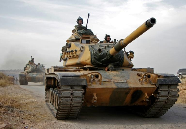 Turkish forces advance north of the Syrian city of Manbij as part of a sweeping offensive against the Kurds (AFP Photo/Aref TAMMAWI)