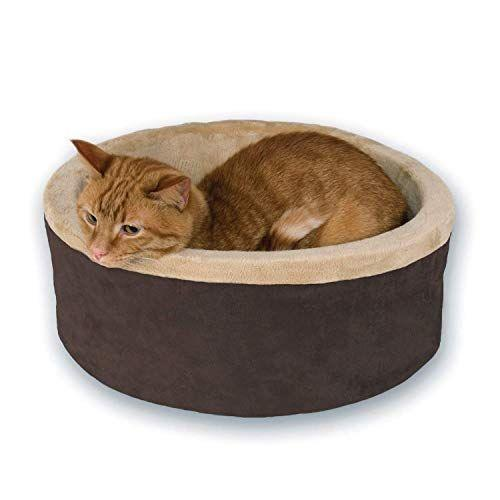 """<p><strong>K&H PET PRODUCTS</strong></p><p>amazon.com</p><p><strong>$45.99</strong></p><p><a href=""""https://www.amazon.com/dp/B07HML9YLD?tag=syn-yahoo-20&ascsubtag=%5Bartid%7C2164.g.32816249%5Bsrc%7Cyahoo-us"""" rel=""""nofollow noopener"""" target=""""_blank"""" data-ylk=""""slk:Shop Now"""" class=""""link rapid-noclick-resp"""">Shop Now</a></p><p>Our pets deserve the world, which is why any cat owner will be overjoyed to receive this plush, heated pet bed for their feline to snooze on.</p>"""