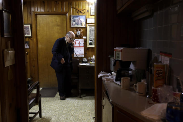 In this Tuesday, Oct. 30, 2012 photo, Dr. Russell Dohner makes a phone call in his office in Rushville, Ill. Even when the medical profession changed around him, he was always on call, ready to drop everything for a patient who might need him. (AP Photo/Jeff Roberson)