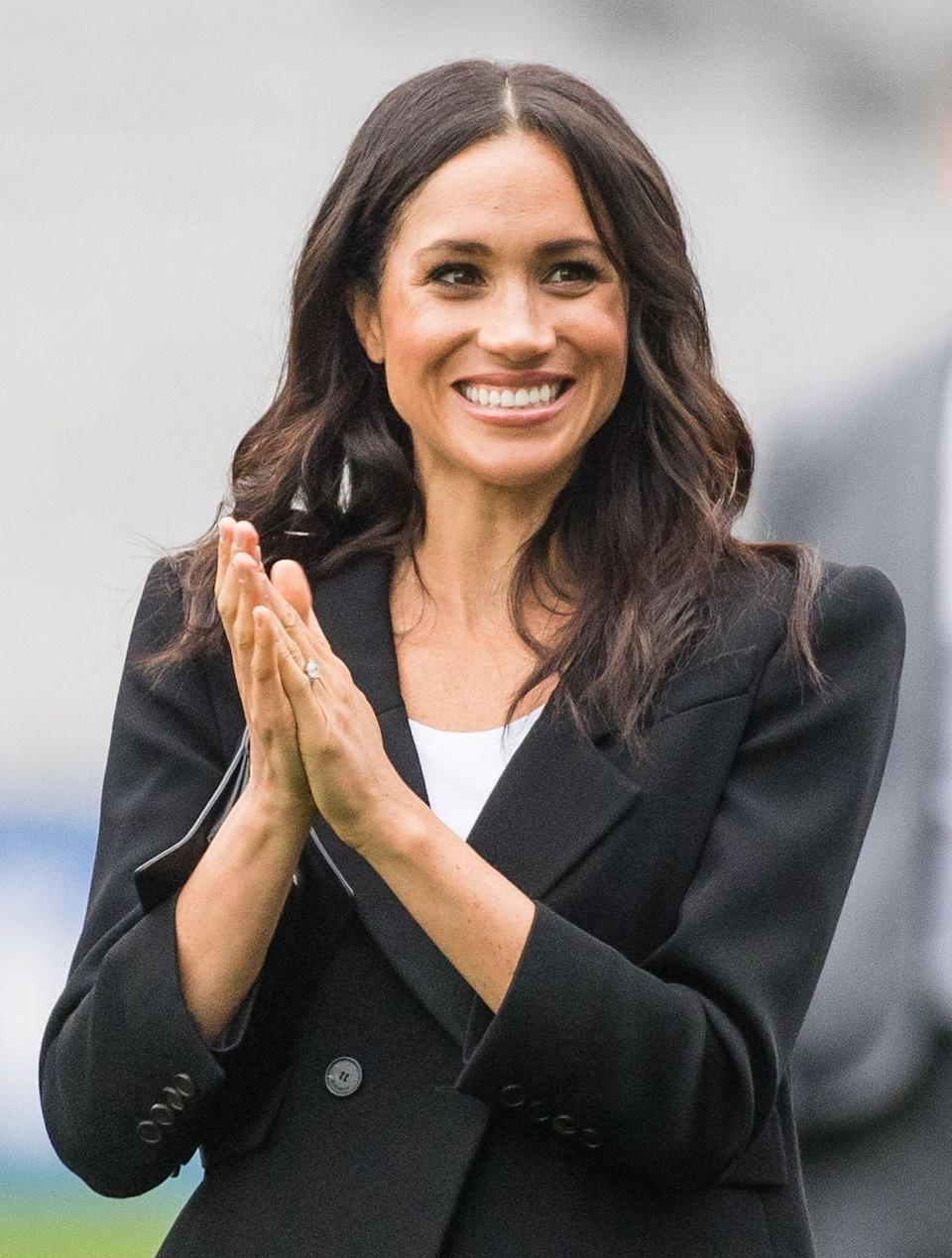 <p>Nearly-beachy waves and curls have become one of Markle's signature styles.</p>