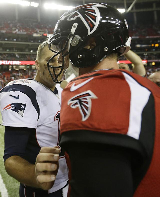 New England Patriots quarterback Tom Brady (12) speaks with Atlanta Falcons quarterback Matt Ryan (2) after the second half of an NFL football game, Sunday, Sept. 29, 2013, in Atlanta. The Patriots won 30-23. (AP Photo/David Goldman)