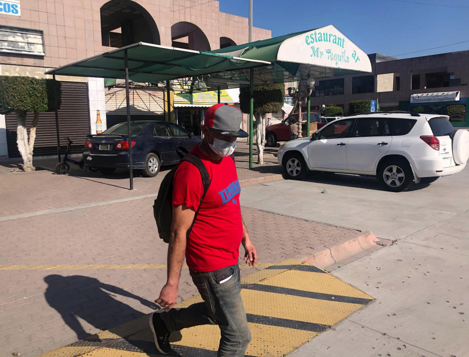 "Jose Magana walks in Tijuana on Oct. 8, 2020, after being expelled from the U.S., for the eighth time since May. President Donald Trump's reshaping of U.S. immigration policy may be most felt in his undoing of asylum. With immigration laws temporarily suspended at the border during the pandemic, people who enter the U.S. illegally are immediately ""expelled"" without even a piece of paper to record the incident. (AP Photo/Elliot Spagat)"