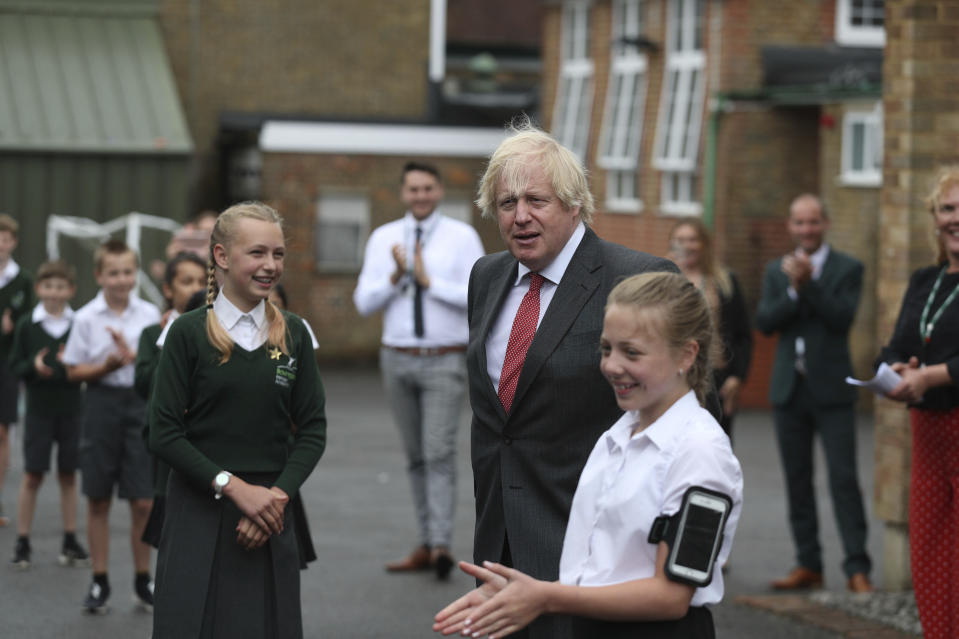 Britain's Prime Minister Boris Johnson joins a socially distanced lesson during a visit to Bovingdon Primary School in Bovingdon, Hemel Hempstead, England, Friday June 19, 2020. (Steve Parsons/Pool via AP)