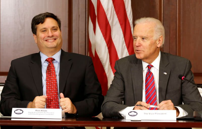 FILE PHOTO: FILE PHOTO - U.S. Vice President Joe Biden is joined by Ebola Response Coordinator Ron Klain (L) in the Eisenhower Executive Office Building on the White House complex in Washington