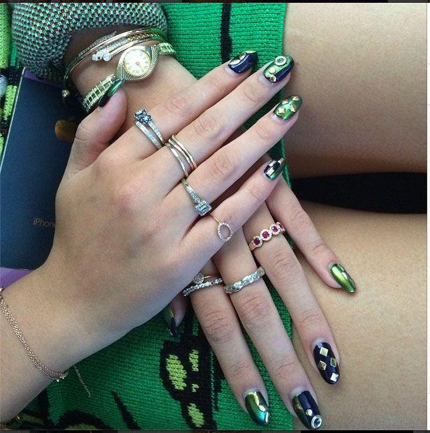 <p>Bella hit up New York Fashion Week rocking the coolest 3D nail art! The combo of navy and emerald colors make the mani super unique. The glam design is made even better by her killer ring game!</p>