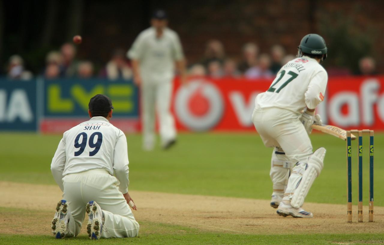 KIDDERMINSTER, UNITED KINGDOM - SEPTEMBER18:  Middlesex fielder Owais Shah adopts an unusual fielding position during day two of the Liverpool and Victoria County Championship Division Two Game between Worcestershire and Middlesex at Kidderminster Cricket Club on September 18, 2008 in Kidderminster, England.  (Photo by Stu Forster/Getty Images)