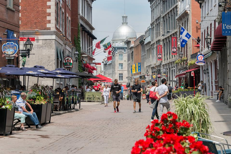 Montreal, CANADA - 12 June 2017: Tourists walking on St Paul Street and visiting Old Montreal in Summer.