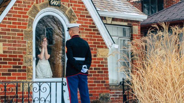 PHOTO: Jon Trommer, a Marine, surprised his girlfriend by popping the question on her snowy doorstep. (Katherine Anne Photography)