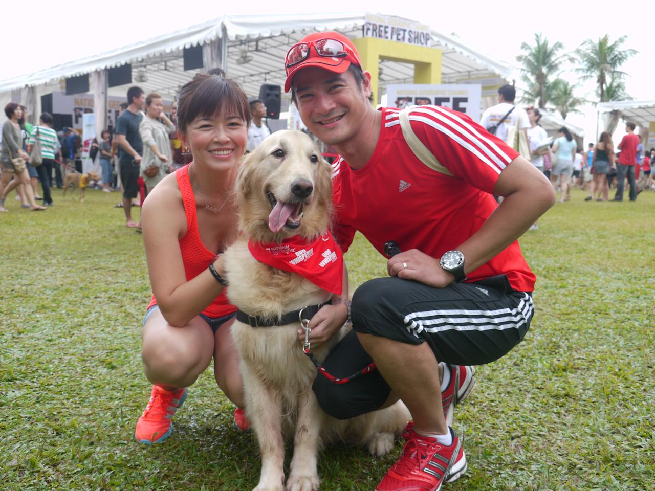 Fly Entertainment artistes Melody Chen and Randall Tan posing with their friend's dog (Yahoo! Photos/Clarence Chen)