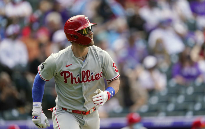 Philadelphia Phillies' Bryce Harper heads up the first-base line after flying out againt Colorado Rockies relief pitcher Robert Stephenson in the eighth inning of a baseball game Sunday, April 25, 2021, in Denver. Colorado won 12-2. (AP Photo/David Zalubowski)
