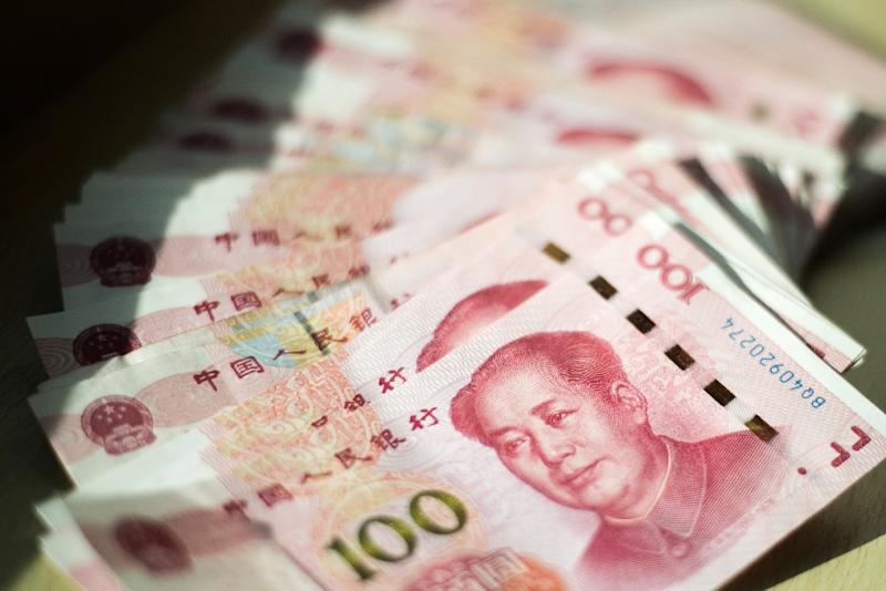 The annual limit for how much cash cardholders can withdraw overseas will be set at 100,000 yuan ($15,355) per person starting 2018