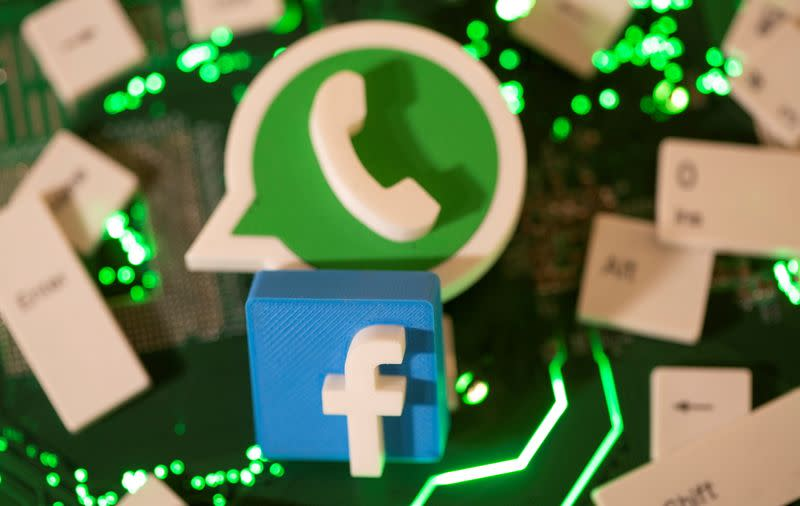 FILE PHOTO: Illustration of 3D printed Facebook and WhatsApp logos and keyboard buttons on a computer motherboard