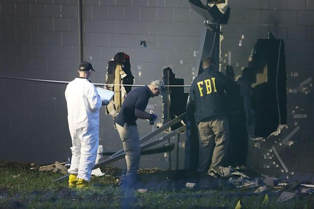 <p>FBI agents investigate near the damaged rear wall of the Pulse Nightclub where Omar Mateen allegedly killed at least 50 people on June 12, 2016 in Orlando, Florida. (Joe Raedle/Getty Images) </p>