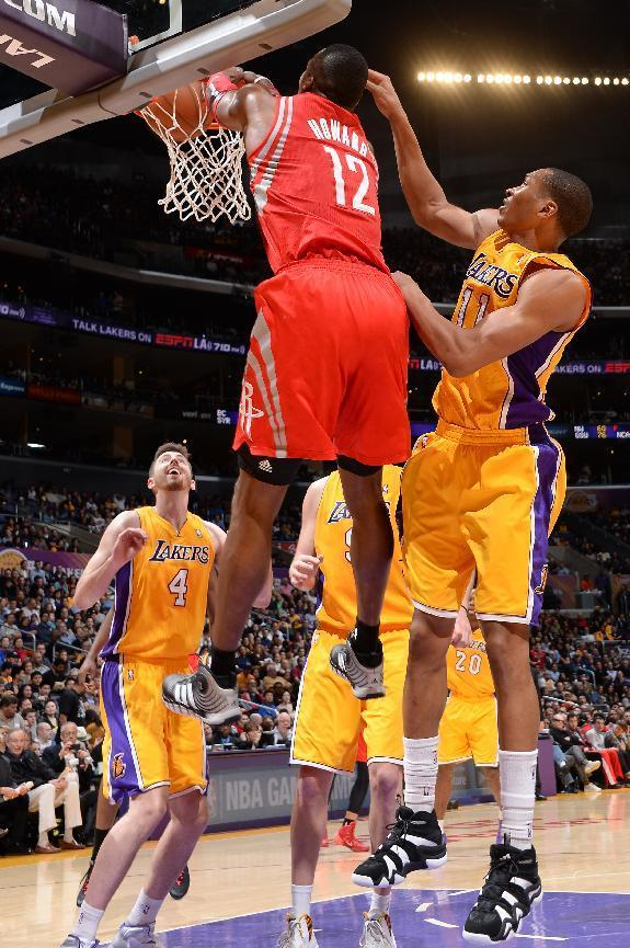 LOS ANGELES, CA - FEBRUARY 19: Dwight Howard #12 of the Houston Rockets dunks during a game against the Los Angeles Lakers at STAPLES Center on February 19, 2014 in Los Angeles, California. (Photo by Andrew D. Bernstein/NBAE via Getty Images)