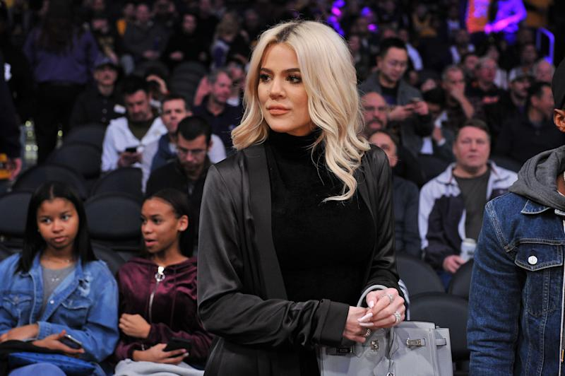 Khloe Kardashian is photographed at a sports game