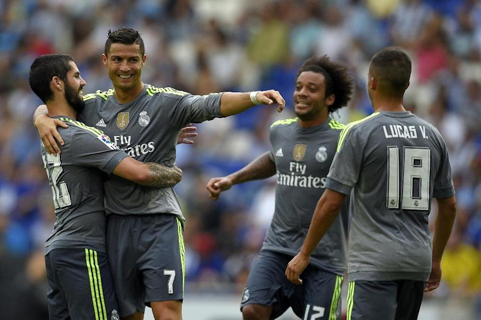 Real Madrid's Cristiano Ronaldo (2nd L) celebrates with teammates Isco (L) and Marcelo (2nd R) after scoring during the La Liga match against Espanyol at the Power8 stadium in Cornella de Llobregat on September 12, 2015 (AFP Photo/Lluis Gene)