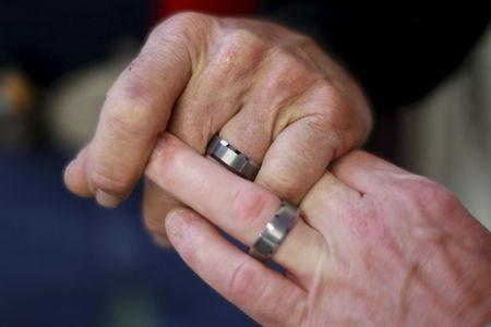 "Gordon Satterly, 61, from Michigan (L) holds hands with his husband Richard Brand, 53, from Texas, at the International Gay Rodeo Association's Rodeo In the Rock party in Little Rock, Arkansas, United States April 24, 2015. REUTERS/Lucy Nicholson PICTURE 27 OF 27 FOR WIDER IMAGE STORY ""GAY RODEO IN LITTLE ROCK"""