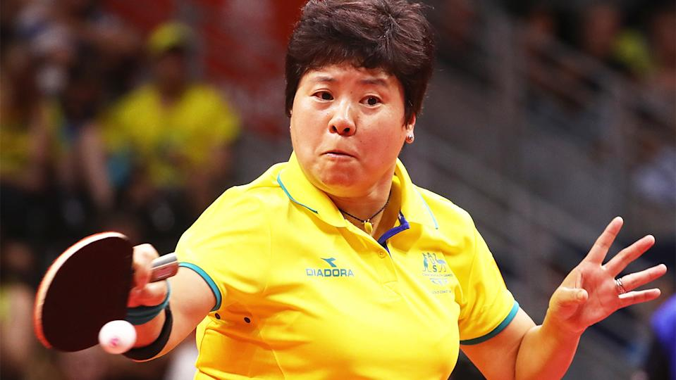 Olympian Jian Fang Lay (pictured) hits the table tennis ball.