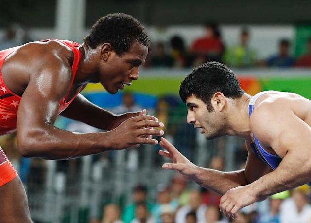 American J'den Michael Tbory Cox (red) wrestling with Iran's Alireza Mohammad Karimi Mashiani at the Rio Games. The Iranian picked up a six months ban in November for deliberately avoiding an Israeli opponent (AFP Photo/Jack GUEZ)