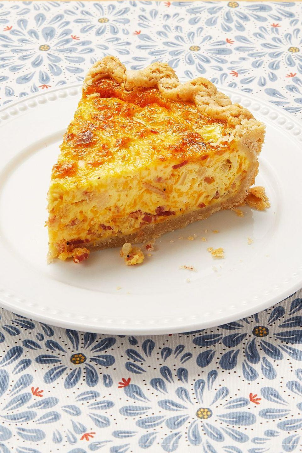 """<p>This hearty quiche is made with bacon, caramelized onions, and cheddar cheese. It's ideal for an Easter lunch!</p><p><a href=""""https://www.thepioneerwoman.com/food-cooking/recipes/a11074/cowboy-quiche/"""" rel=""""nofollow noopener"""" target=""""_blank"""" data-ylk=""""slk:Get the recipe."""" class=""""link rapid-noclick-resp""""><strong>Get the recipe.</strong></a></p><p><a class=""""link rapid-noclick-resp"""" href=""""https://go.redirectingat.com?id=74968X1596630&url=https%3A%2F%2Fwww.walmart.com%2Fsearch%2F%3Fquery%3Ddeep%2Bdish%2Bpie%2Bplate&sref=https%3A%2F%2Fwww.thepioneerwoman.com%2Ffood-cooking%2Fmeals-menus%2Fg35585877%2Feaster-recipes%2F"""" rel=""""nofollow noopener"""" target=""""_blank"""" data-ylk=""""slk:SHOP DEEP DISH PIE PLATES"""">SHOP DEEP DISH PIE PLATES</a></p>"""
