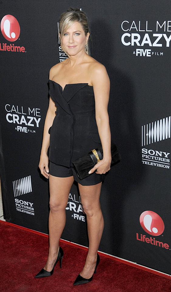 "Jennifer Aniston has been MIA on the red carpet for quite some time, but the former ""Friends"" star made a triumphant return to the spotlight on Tuesday evening at the ""Call Me Crazy"" premiere in West Hollywood, California. The black bustier -- courtesy of Christian Dior -- makes her shoulders look a little wide, but they're such beautiful shoulders, so no complaints. And the matching shorts and Jimmy Choo heels made her tanned gams look as tantalizing as ever. (4/16/2013)"