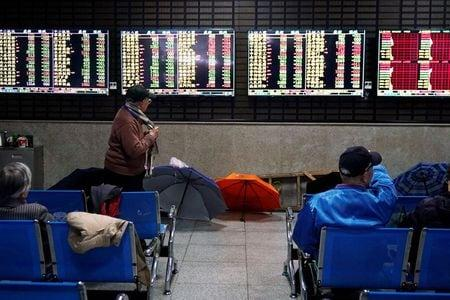 World shares sink as data points to tepid economic revival