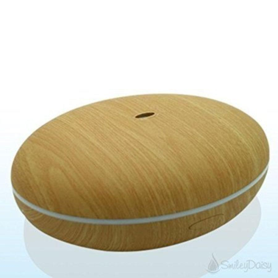 """<p>Seeking more of a natural look in a diffuser? Smiley Daisy's Essential Oil Diffuser is an organic wood grain delight with a unique seed-pod design. It still offers color-changing LED light, but in a gentler, subtle strip through the center. Best of all, <a href=""""https://store.smileydaisy.com/products/essential-oil-diffuser-by-smiley-daisy"""" rel=""""nofollow noopener"""" target=""""_blank"""" data-ylk=""""slk:user reviews"""" class=""""link rapid-noclick-resp"""">user reviews</a> say the Hibiscus puts out one of the strongest streams of mist of any diffuser on the market.</p> <p><strong>$41</strong> (<a href=""""https://www.amazon.com/Essential-Diffuser-Smiley-Whisper-Quiet-Humidifier/dp/B00MPV4738?"""" rel=""""nofollow noopener"""" target=""""_blank"""" data-ylk=""""slk:Shop Now"""" class=""""link rapid-noclick-resp"""">Shop Now</a>)</p>"""