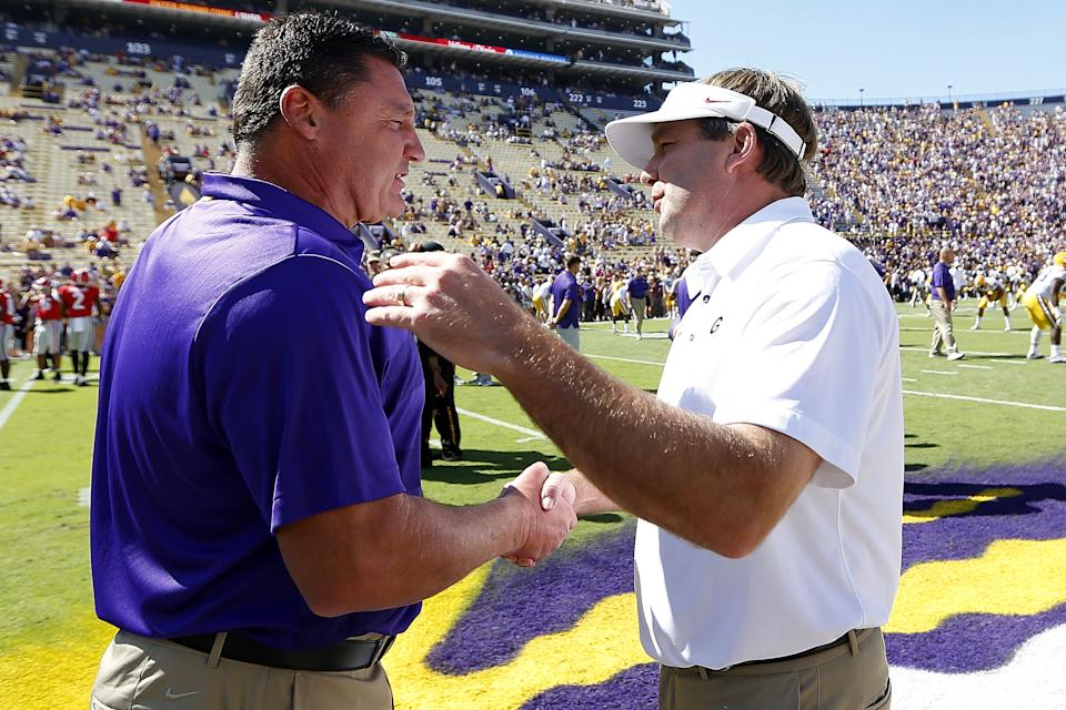 BATON ROUGE, LA - OCTOBER 13:  Head coach Ed Orgeron (L) of the LSU Tigers and head coach Kirby Smart of the Georgia Bulldogs meet on the field before a game at Tiger Stadium on October 13, 2018 in Baton Rouge, Louisiana.  (Photo by Jonathan Bachman/Getty Images)