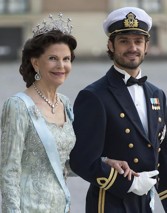 STOCKHOLM, SWEDEN - JUNE 08: Queen Silvia of Sweden and Prince Carl Philip of Sweden attend the wedding of Princess Madeleine of Sweden and Christopher O'Neill hosted by King Carl Gustaf and Queen Silvia at The Royal Palace on June 8, 2013 in Stockholm, Sweden. (Photo by Mark Cuthbert/Julian Parker/UK Press via Getty Images)