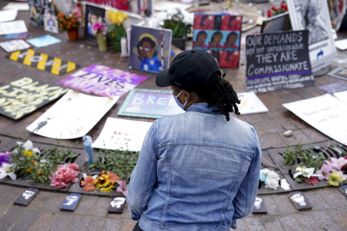 """Millicent Cahoon stands for a portrait, Thursday, Sept. 24, 2020, in Louisville, Ky. """"It's reiterating to me that my life does not matter, that I'm unsafe,"""" said Millicent Cahoon, a therapist who started a counseling network for the protest movement. (AP Photo/John Minchillo)"""