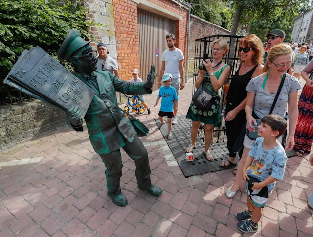 "<p>An artist called ""Le Facteur/The Postman"" takes part in the festival ""Statues en Marche"" in Marche-en-Famenne, Belgium, July 22, 2018.(Photo: Yves Herman/Reuters) </p>"