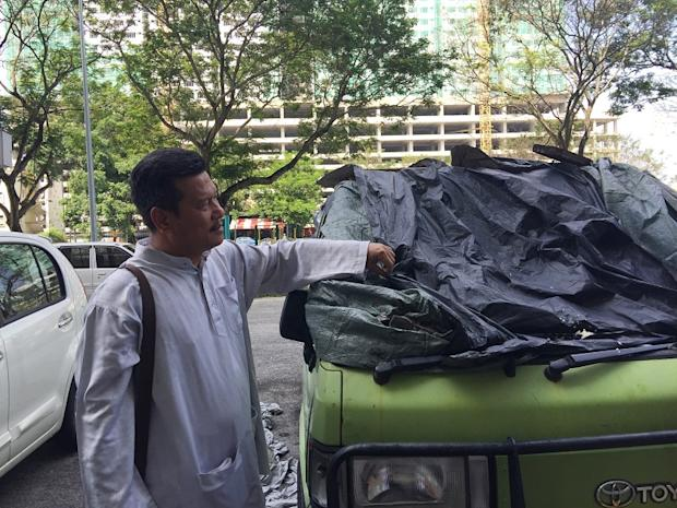 Zainol Abidin Shariff showing a vehicle with its windscreen shattered from a falling item at Jalan Sungai PPR.