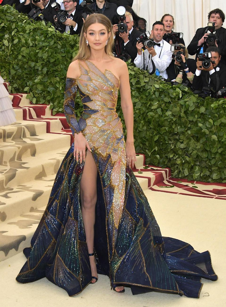 After a year of a very public relationship (and breakup), Gigi stepped out on her own in this gorgeous gown serving Rainbow Fish-realness. The multi-colored pattern along her dress blended into her skin flawlessly.