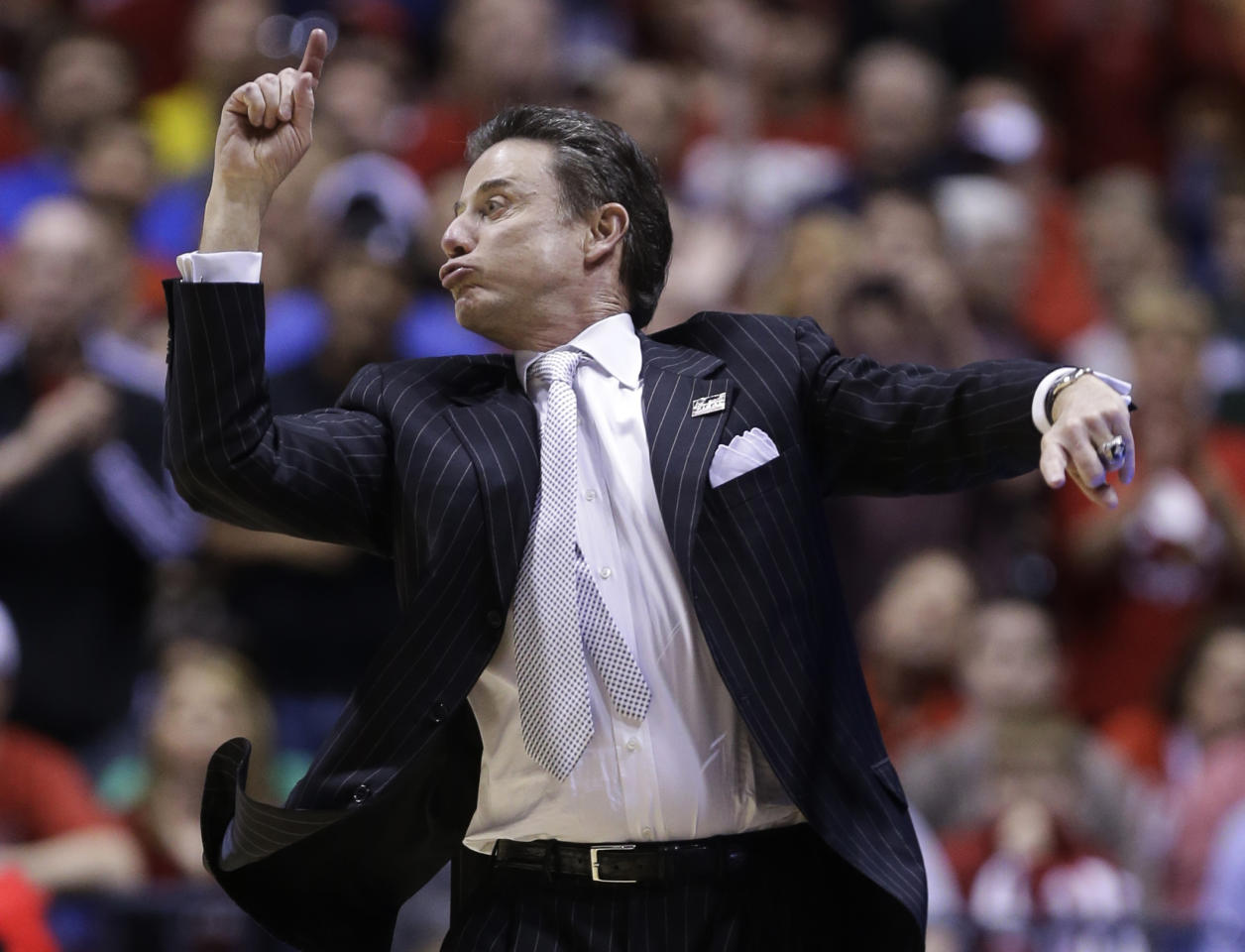Louisville head coach Rick Pitino directs his team during the second half of the Midwest Regional final against Duke in the NCAA college basketball tournament, Sunday, March 31, 2013, in Indianapolis. Louisville won 85-63 to advance to the Final Four. (AP Photo/Michael Conroy)