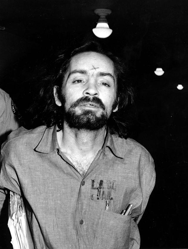 <p>Unsuccessful in his attempts to obtain a mistrial, Charles Manson heads for court in Los Angeles on Aug. 6, 1970, to listen to further cross-examination of the state's star witness, Linda Kasabian, in his trial for murder in the slayings of actress Sharon Tate and six other people. (Photo: AP) </p>
