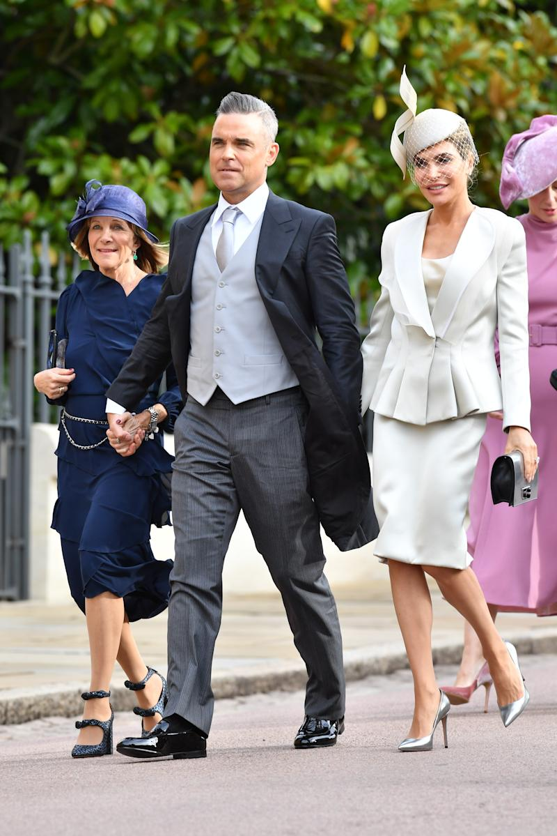 Robbie Williams and Ayda Field attend the wedding of Princess Eugenie of York to Jack Brooksbank at St. George's Chapel on October 12, 2018, in Windsor, England.