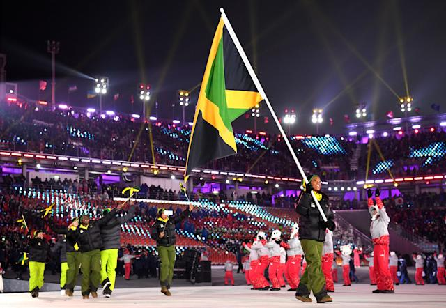 <p>Flag bearer Audra Segree of Jamaica and teammates arrive during the Opening Ceremony of the PyeongChang 2018 Winter Olympic Games at PyeongChang Olympic Stadium on February 9, 2018 in Pyeongchang-gun, South Korea. (Photo by Matthias Hangst/Getty Images) </p>