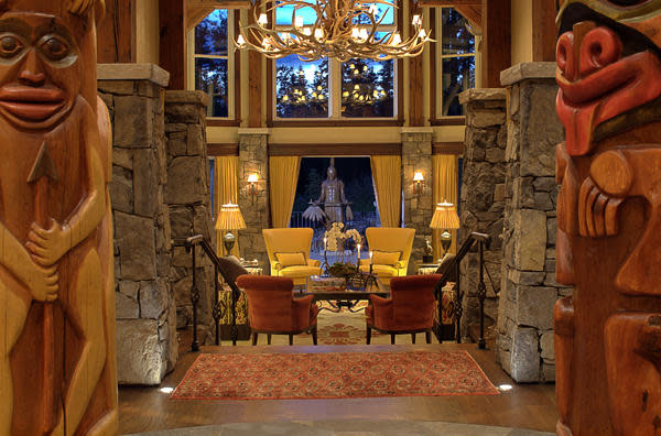 "<p>This 10,000-square-foot home is an architectural dream, with totem poles flanking the great room. (Listing via <a href=""http://calgary.evcanada.com/en/listing/cms/123cairnslanding/"" rel=""nofollow noopener"" target=""_blank"" data-ylk=""slk:Engel & Volkers"" class=""link rapid-noclick-resp"">Engel & Volkers</a>) </p>"