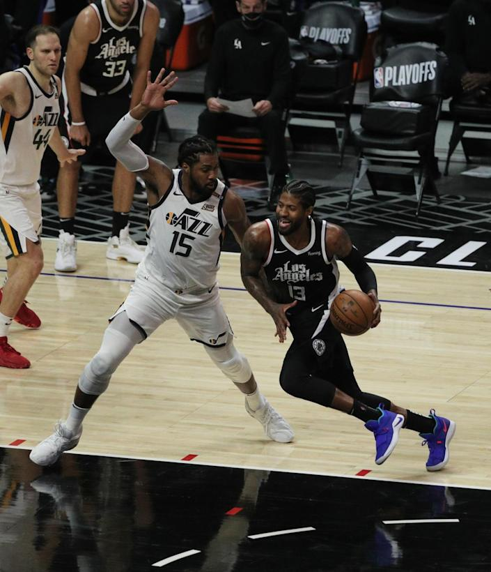 The Clippers' Paul George drives to the basket against the Utah Jazz's Derrick Favors in the second half June 12, 2021.