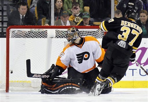 Boston Bruins' Patrice Bergeron (37) scores on Philadelphia Flyers' Ilya Bryzgalov in a shootout during an NHL hockey game in Boston, Saturday, March 17, 2012. The Bruins won 3-2. (AP Photo/Michael Dwyer)