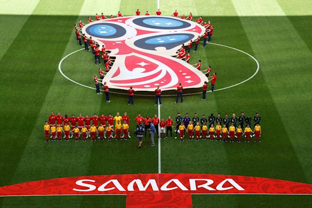 Soccer Football - World Cup - Group C - Denmark vs Australia - Samara Arena, Samara, Russia - June 21, 2018 Denmark and Australia players line up during the national anthems before the match REUTERS/David Gray