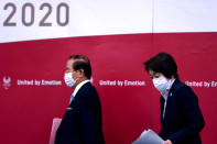 Tokyo 2020 president Seiko Hashimoto, right, and CEO Toshiro Muto attend a press conference, in Tokyo, Thursday, July 8, 2021. (Behrouz Mehri/Pool Photo via AP)