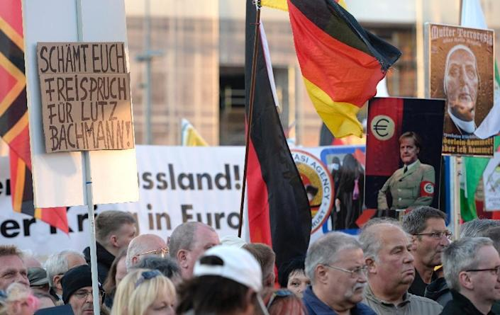 A poster reads 'Shame on you. Free speech for Lutz Bachmann' during the far-right Pegida rally on April 18, 2016 in Dresden (AFP Photo/Robert Michael)